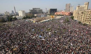 A crowd  of protesters gathers in Tahrir Square in Cairo, Egypt.