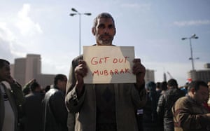 Egypt placards: An anti-government protester with a simple sign in Cairo, Egypt