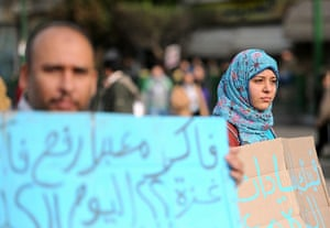 Egypt protests: An Egyptian man and woman hold up signs