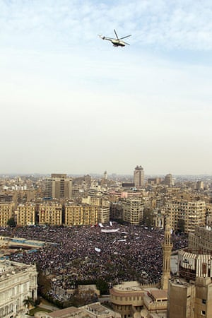 Egypt protests: An Egyptian military helicopter flies over Tahrir square
