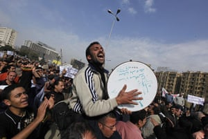 Egypt protests: A musician performs in Tahrir Square