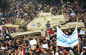 Egypt protests: A tank stands amid crowds as protesters gather on Tahrir Square in Cairo