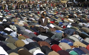 Egypt protests: Demonstrators pray in Tahrir Square in Cairo