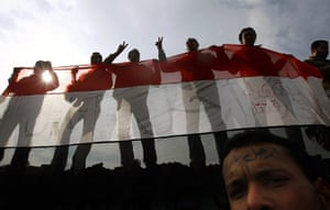 Egypt protests: Anti-government protesters wave an Egyptian flag in Tahrir Square