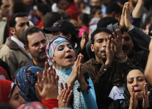Egypt protests: Demonstrators react in Tahrir Square in Cairo