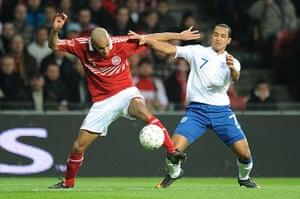 Denmark v England: Theo Walcott and Simon Poulsen tussle for the ball