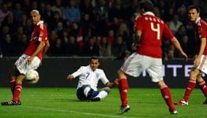 Denmark v England: Theo Walcott crosses the ball for Darren Bent to score