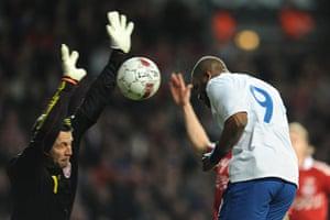 Denmark v England: Thomas Sorensen blocks Darren Bent's header