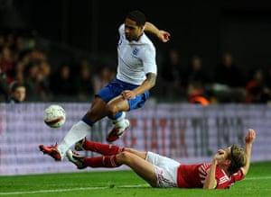 Denmark v England: DenChristian Poulsen tackles Glen Johnson
