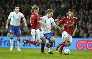 Denmark v England: Jack Wilshere bursts between Christian Poulsen and William Kvist Jorgensen