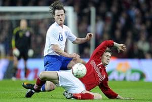 Denmark v England: Scott Parker is tackled by Nicklas Bendtner