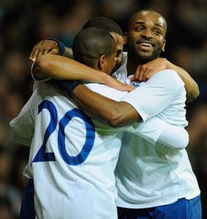 Denmark v England: Darren Bent, Glen Johnson celebrate with goalscorer Ashley Young