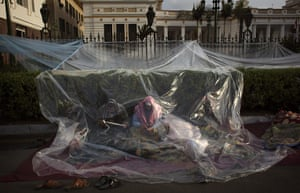 Egypt day 17: Anti-government protesters sit behind plastic sheets outside Parliament