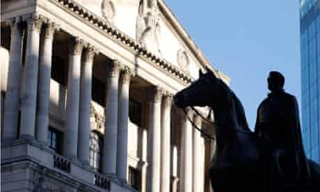A statue is seen outside the Bank of England in the City of London