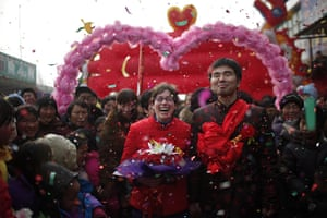 from the agencies: Rebecca Kanthor and Liu Jian smile during their traditional Chinese wedding