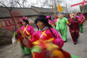 from the agencies: Locals wearing traditional costumes take part in the wedding procession