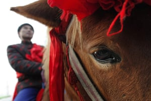 from the agencies: Liu Jian rides a horse during his traditional Chinese wedding