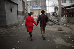 from the agencies: Rebecca Kanthor and Liu Jian walk along an empty street after their wedding