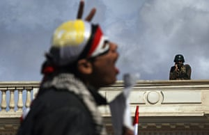 Egypt day 17: An anti-government protester chants as an Egyptian army soldier watches