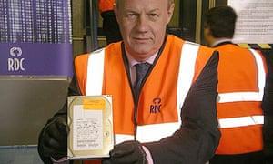 ID register shredded: Damian Green holding hard drive