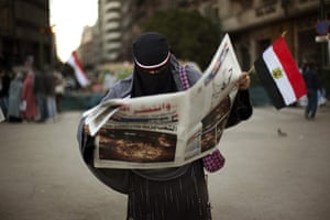 Egypt Day 19: An Egyptian woman reads the newspaper in Tahrir Square