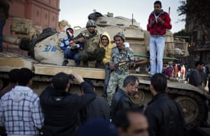 Egypt Day 19: Egyptians next to an Army soldier on top of a tank in Tahrir Square