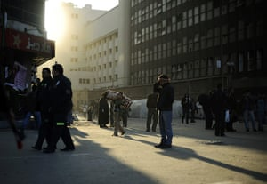 Egypt Day 19: The sun rises on anti-government protesters as they leave Tahrir Square
