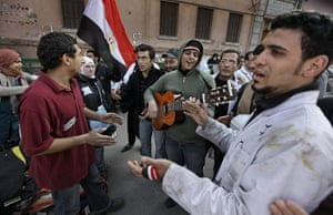 Egypt Day 19: A man plays his guitar in support for doctors who had run a medical clinic