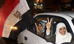 Egypt reaction: Palestinian women wave an Egyptian flag