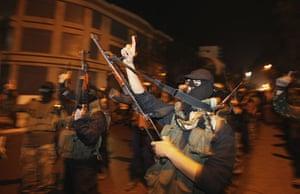 Egypt reaction: Palestinians Hamas militants celebrate the resignation of President Mubarak