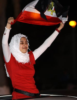 Egypt reaction: A youth waves an Egyptian flag