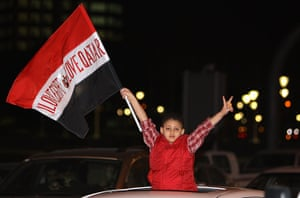 "Egypt reaction: A boy waves an Egyptian flag reading ""I"