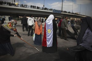 Egypt Day 19: Egyptian volunteers help to clean up the roads near Tahrir Square