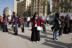 Egypt Day 19: Egyptian volunteers form a human chain to direct visitors at Tahrir Square