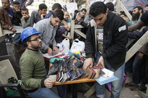 Egypt Day 19: Egyptian protesters set up a desk for found wallets in Tahrir Square