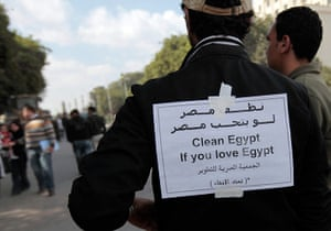 Egypt aftermath: Opposition supporters continue clean-up work in Tahrir Square in Cairo