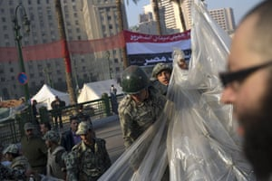 Egypt aftermath: Egyptian soldiers dismantle a tent used by protestors