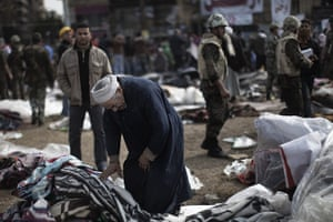 Egypt aftermath: An elderly Egyptian clears his belongings from camp site