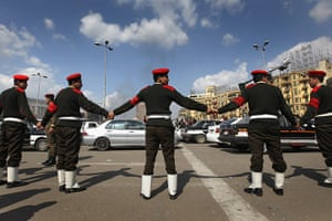 Egypt update: Egyptian army soldiers block pedestrians after opening Tahrir Square