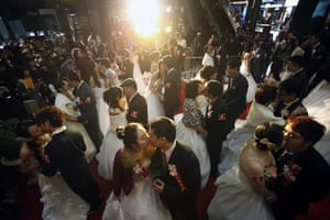 Valentine's Day: Taipei, Taiwan: Couples kiss during a mass wedding ceremony
