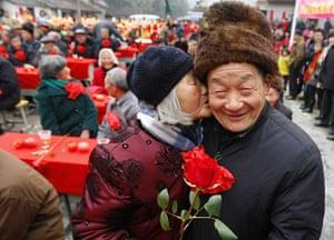 Valentine's Day: Zhuji city, China: Jin Juhua kisses her husband Zhong Weiqiao