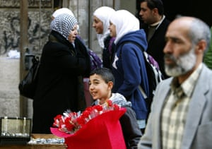 Valentine's Day: Ramallah, West Bank: A Palestinian boy sells flowers for Valentine's Day