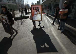 Valentine's Day: Beijing, China: Women pose for photographs with a picture board