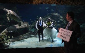 Valentine's Day: London, England: Aquarists take part in a blessing in the Aquarium