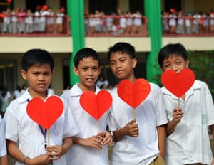 Valentine's Day: Manila, Philippines: Students from an elementary school with paper hearts