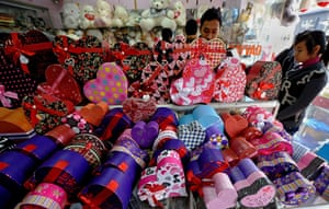 Valentine's Day: Hanoi , Vietnam: Young people browse for Valentine Day's gifts at a shop