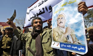 Arab unrest: government supporter waves a dagger  in Yemen