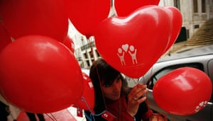 Valentine's Celebrations: A woman holds Valentine's Day balloons in Lisbon