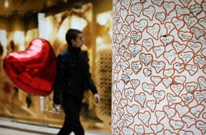 Valentine's Celebrations: A Bulgarian carries a red heart balloon