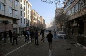 iran protests: Iranian protestors throw stones at riot police